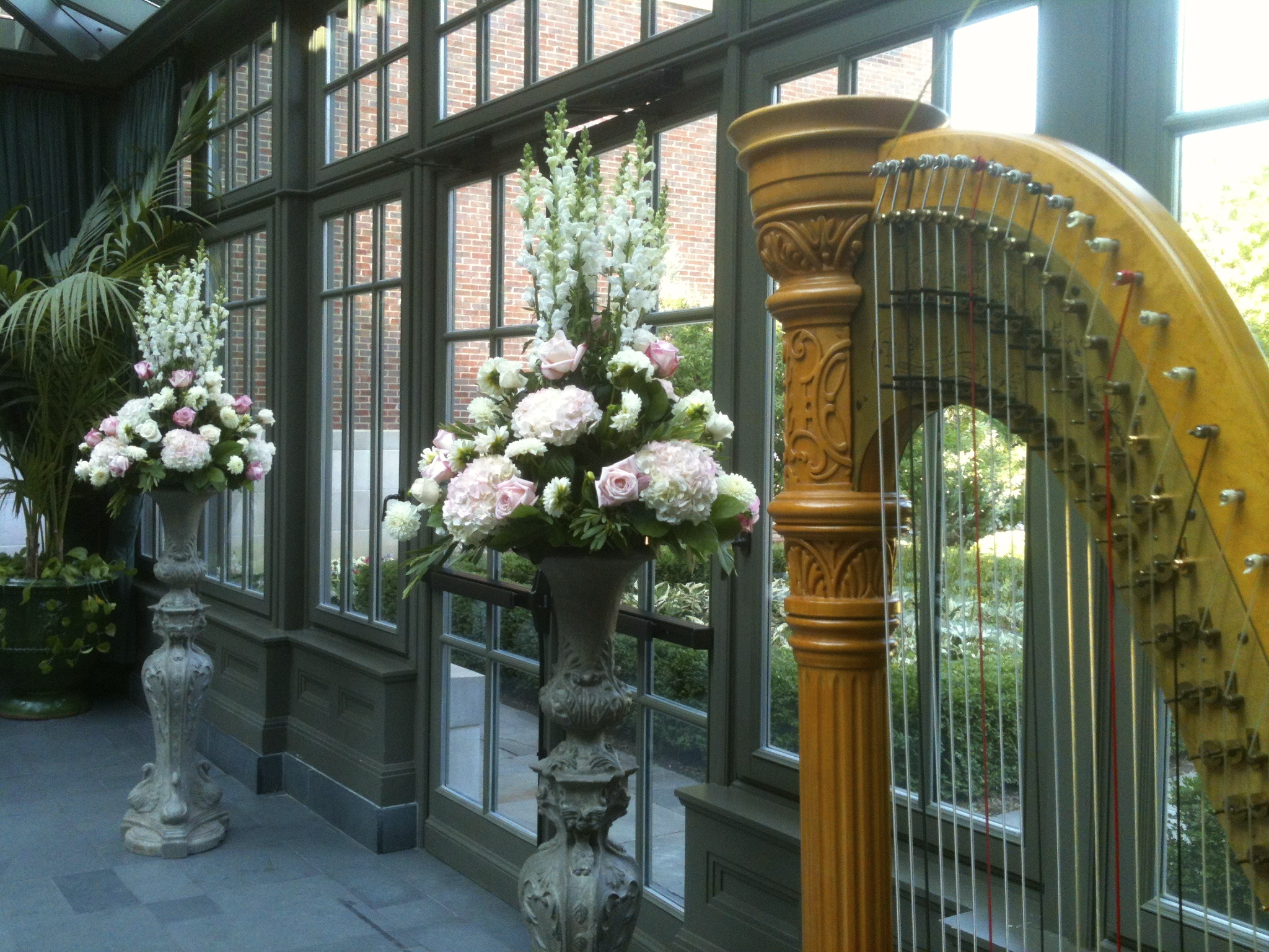 The flowers and the harp go together so beautifully in the conservatory.