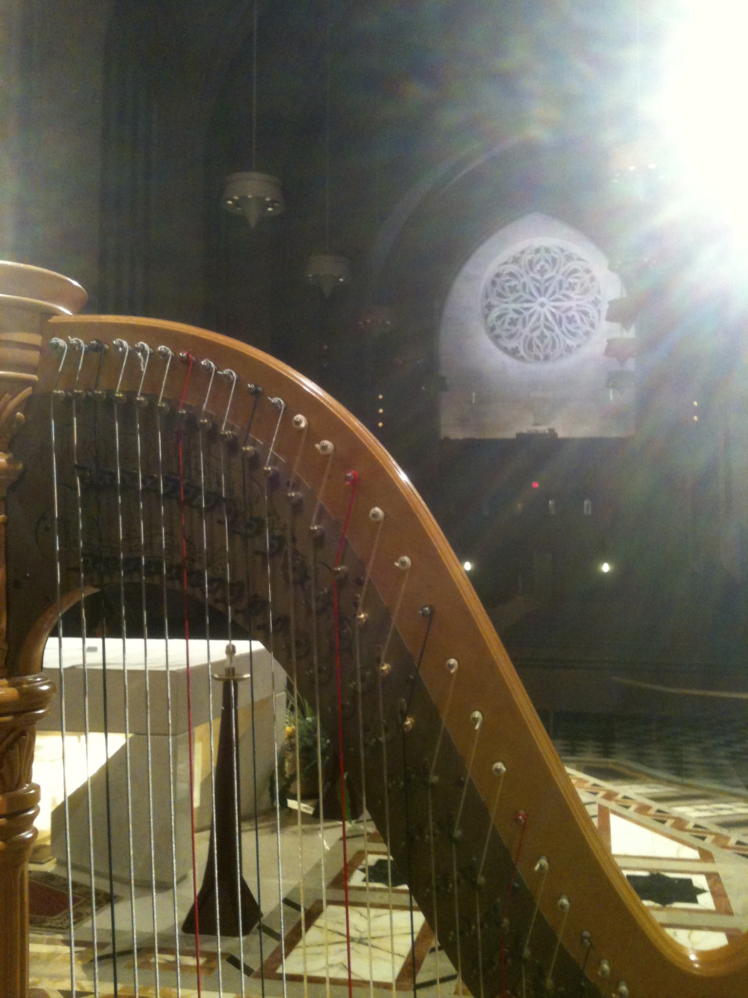 Divine Light is shining down upon the harp.